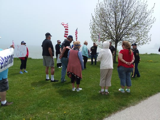 Members of the Republican Party of Manitowoc County participate in a Memorial Day walk amid the coronavirus pandemic.