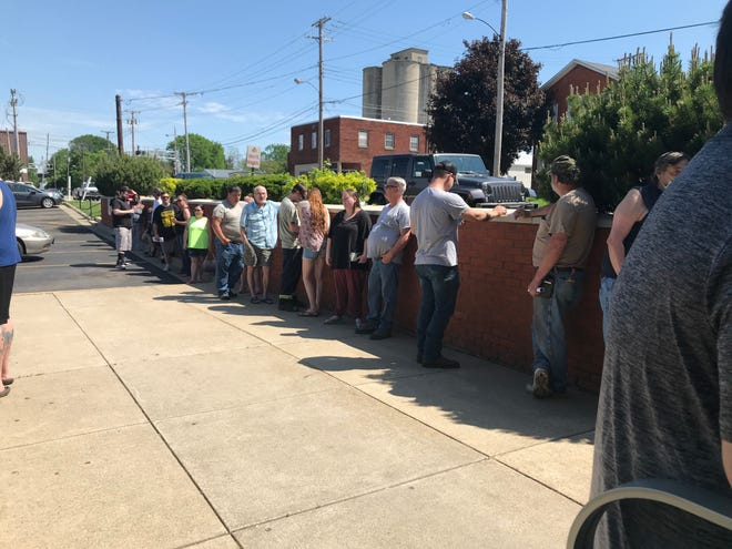 A line of about 20 people stretches outside Marion's Bureau of Motor Vehicle office on Tuesday, when BMV offices across Ohio were reopened.