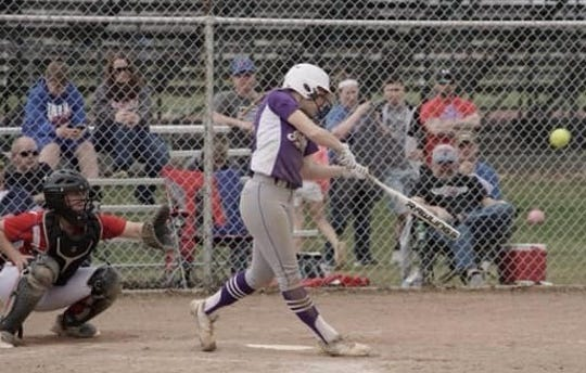 Mckenzie Bump of Mount Gilead hits the softball during a high school game last season. Bump will play at Ohio State next season.