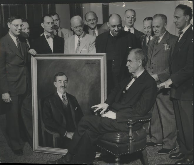 Long time friends of Daniel W. Hoan (seated) presented an oil portrait of the former mayor to the city in 1953.  The painting was accepted by Mayor Frank Zeidler (left) and members of the Hoan Memorial Foundation.