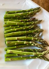 Dietitian Bridgett Wilder recommends colorful vegetables such as asparagus fresh from the farmers market.