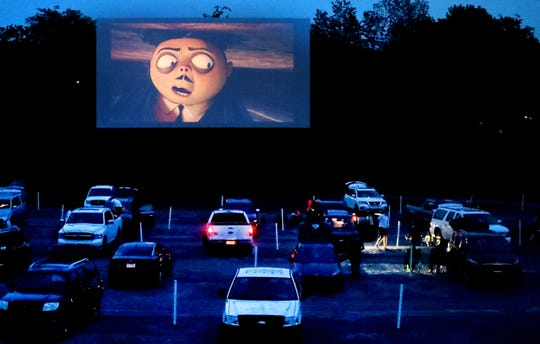 Movie trailers begin as the final vehicles settle into place at the Moonlite Drive-In, on Friday, May 22, 2020, in Woodbury.