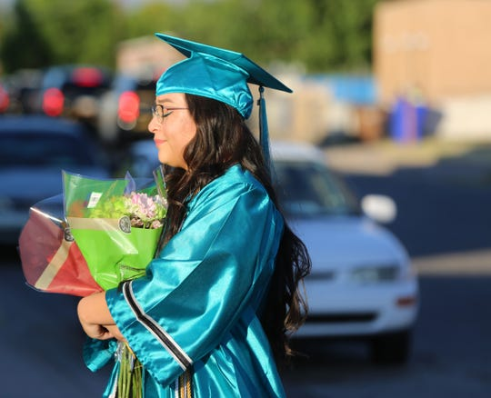JanileyChavez, 18 takes a moment to remember her dad Jose Chavez, a police officer who was killed in the line of duty in 2016, during her graduation festivities, Friday May 22, 2020.