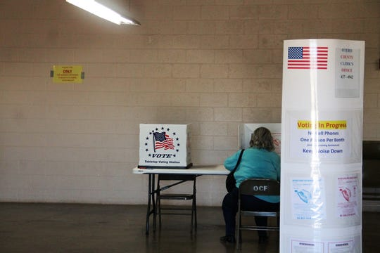 A voter fills out their ballot at early voting at the Otero County Fairgrounds May 26, 2020.