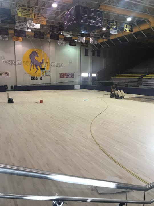 Kirtland Central's Bronco Arena went through $25,000 worth of renovations this month, which included sanding down the floor and adding the team's logo to center court.