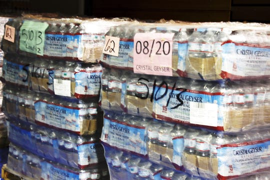 Pallets of water await shipment May 25 in Shiprock, New Mexico as part of a food delivery drive.