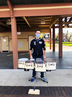 Farmington Schools percussion instructor Zach Desjarlais welcomed opening day visitors to the Farmington Farmers market with an entertaining beat.