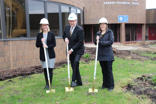 Interim Superintendent Jill Simmons, Board of Education President David Cox and William D. Ford Career-Technical Center Principal Jennifer LaDuke broke ground on the District's first Bond construction project.