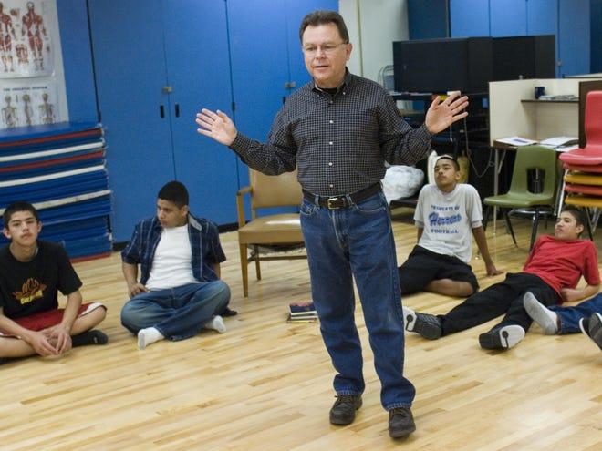 Poet Alberto Ríos speaks to a class that performs dances to his poems at Herrera School in Phoenix.