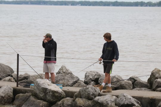 With the flooding having receded over the past few days, fishermen have been returning the Jefferson Street pier near downtown Port Clinton.