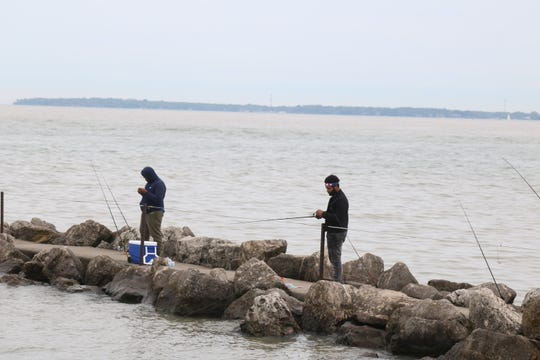Fishermen have been flocking to the Jefferson Street pier near downtown Port Clinton, where they can cast their lines while easily maintaining social distance.