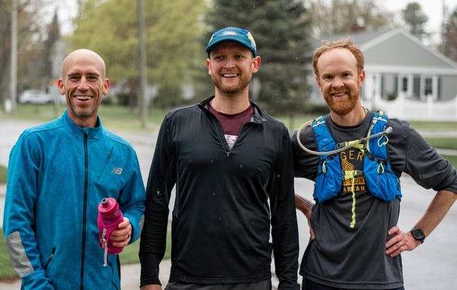 St. Clair Running Club members (l-r) Kurt Brinker, Marvin Schmitz and Nate McDonell pose for a picture after a big run.