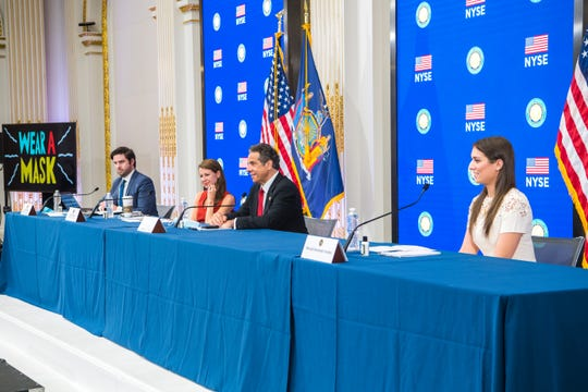 Gov. Andrew M. Cuomo held his daily COVID-19 press briefing at the New York Stock Exchange on May 26, 2020 along with aides Gareth Rhodes, left, Melissa DeRosa and his daughter Mariah Kennedy Cuomo.