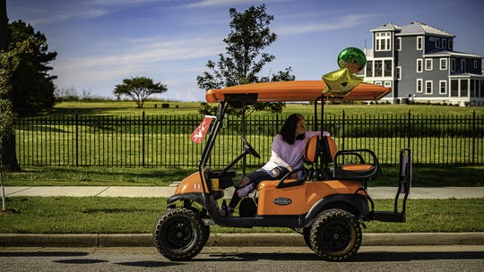 A woman sits in a golf cart on May 23, 2020, in a USA TODAY Network photo from Virginia.