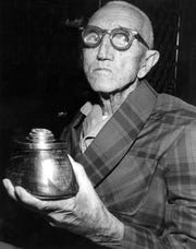 Oct. 24, 1971: George B. Lewis, an 85-year-old retired cavalryman, trained the most famous jumping horse in the Army. Lewis is shown with one of his prized souvenirs of the 7th Cavalry, an inkwell made from a hoof of the famed jumper, Garry Owen.