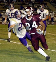 Mt. Whitney's John Taylor takes off down the field during the first half of their West Yosemite League football game with Lemoore at Mineral King Bowl on October 9, 2003.
