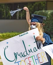 Redwood senior Ella Bovetti and about other 40 seniors representing Visalia's four public high schools gather Tuesday, May 26, 2020 at the district office to protest the handling of graduations.