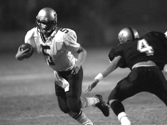 Redwood's Aaron Hill (5) evades Golden West's Miguel Ruiz at Sunkist Stadium in 1999.