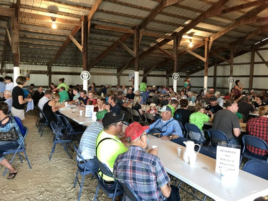Attendees have conversation over breakfast at the Pepin County Dairy Breakfast held at Four C Dairy in 2018.
