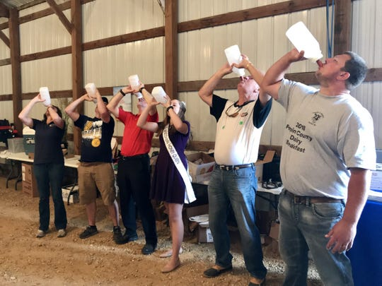 Sheila Harsdorf, Weston Patnode, Warren Petryk, Hannah Sjostrom, Bob Boshold, and Corey Bauer participated in a milk-drinking contest at the Pepin County Dairy Breakfast in 2018.