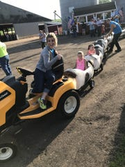 Pepin County Dairy Promotion member Celsey Weiss conducted a train for kids at an annual dairy breakfast.