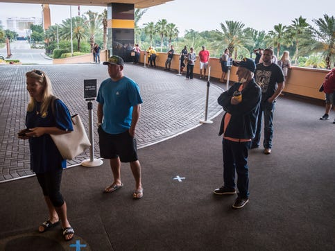 People are lined up moments before the 8 a.m. opening Thursday, May 21, 2020 at Golden Nugget Casino in Biloxi, Miss. on the Mississippi Coast.