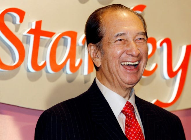 In this Nov. 20, 2006, file photo, Macao tycoon Stanley Ho smiles during a party to celebrate a birthday in Hong Kong. On Tuesday, May 26, 2020, the family of Stanley Ho said he died at 98.