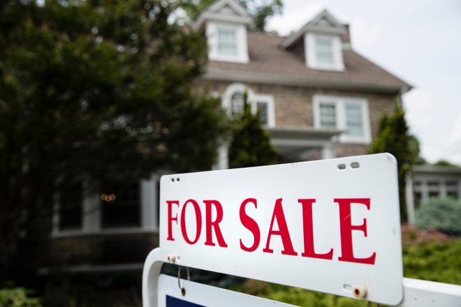 In this June 8, 2018, file photo a for sale sign stands in front of a house, in Jenkintown, Pa.
