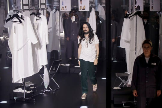 Designer Alessandro Michele walks out at the end of Gucci's Fall/Winter 2020/2021 collection on Feb. 19, 2020. Gucci and St. Laurent are two of the highest profile luxury fashion houses to announce they will leave the fashion calendar behind, with its relentless four-times-a-year rhythm, shuttling cadres of fashionistas between global capitals where they squeeze shoulder-to-shoulder around runways for 15 breathless minutes.