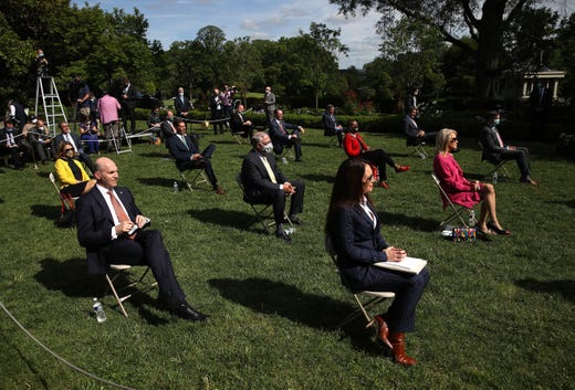 Invited guests listen as U.S. President Donald Trump speaks during an event on protecting seniors with diabetes, in the Rose Garden at the White House on May 26, 2020 in Washington, DC. The United States is closing in on 100,000 deaths in less than four months caused by the coronavirus.