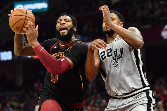Cleveland Cavaliers center Andre Drummond (3) drives to the basket against San Antonio Spurs forward Rudy Gay (22) during the second half at Rocket Mortgage FieldHouse.