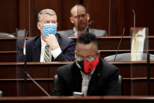 Rep. John Mark Windle, left, D-Livingston, wears a mask due to COVID-19 precautions during a meeting of the House K-12 subcommittee Tuesday, May 26, 2020, in Nashville, Tenn. Lawmakers resumed working inside the legislative facilities Tuesday.