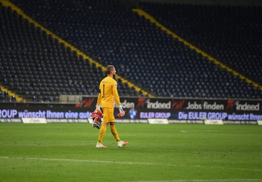 Frankfurt's German goalkeeper Kevin Trapp leaves after the German first division Bundesliga football match Eintracht Frankfurt v SC Freiburg on May 26, 2020 in Frankfurt, western Germany.