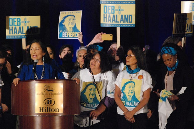 Rep. Debra Haaland, at the podium, seeks support from local party delegates at the Democratic Party preprimary convention in Pojoaque, N.M., in March 2020. Haaland has been working on Native American causes since volunteering for presidential hopeful Barack Obama's campaign in 2008.