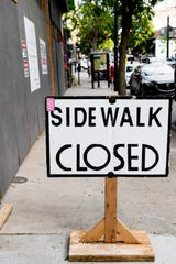 A sidewalk along Broadway Street in downtown Asheville is closed to allow for customers of Mellow Mushroom to distance themselves from one another as they wait in line May 22, 2020.