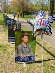 Colchester High School graduates were honored through the streets of town with senior picture lawn signs, seen May 21, 2020. The school placed the signs along the streets of Colchester leading up to the High School in recognition of its graduates who, due to the COVID-19 pandemic, missed out on some senior events.