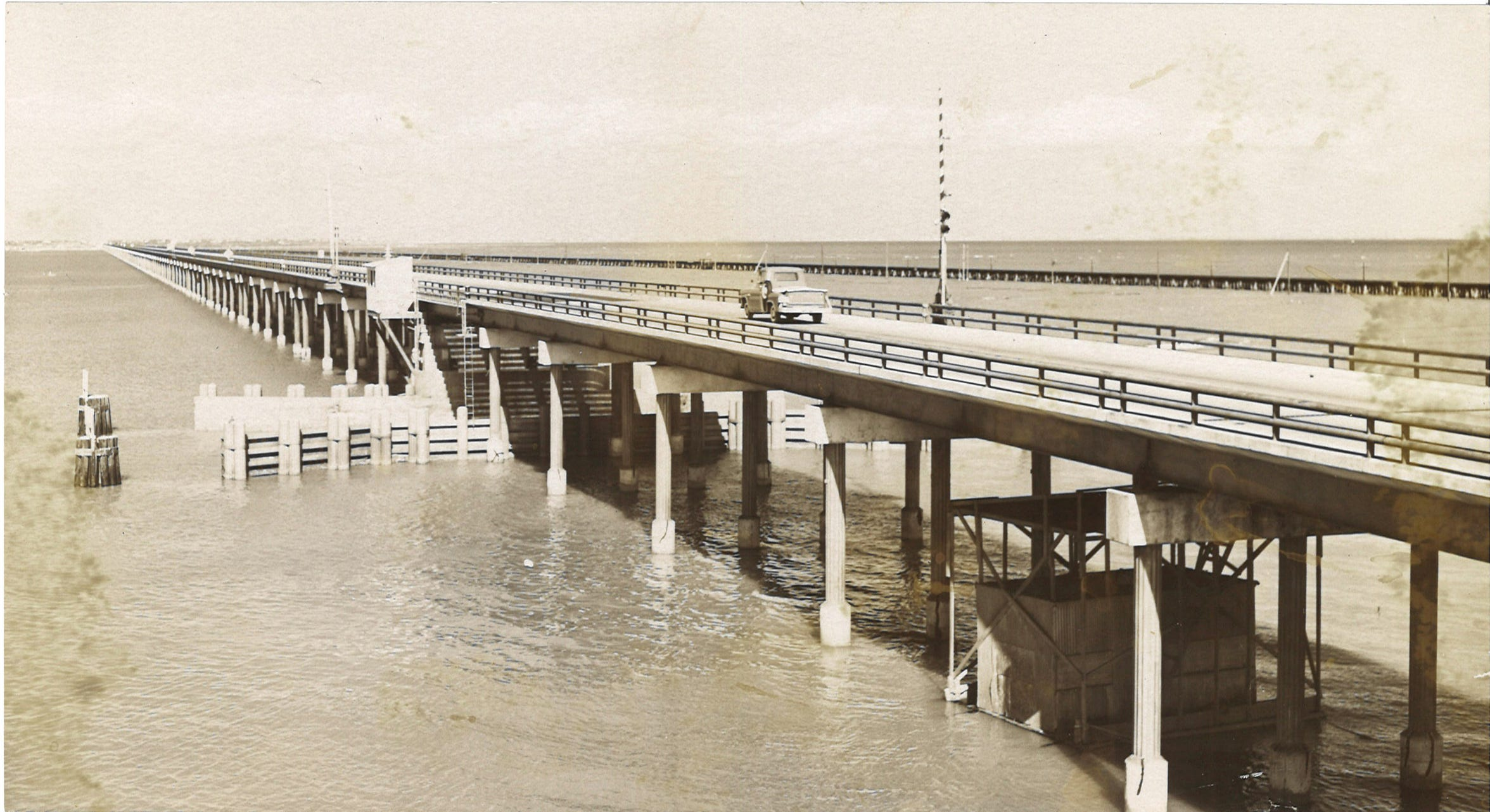 Traffic travels along the Nueces Bay Causeway in October 1959 shortly before the Harbor Bridge opened.
