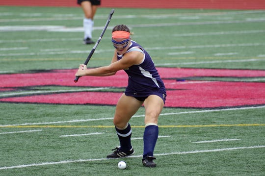 """Collingswood's Lauren """"Lulu"""" O'Neill takes a free hit during a game last season. She will attend and play field hockey at Kutztown University in the fall"""