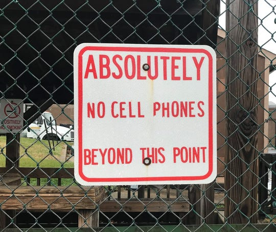A sign warns visitors against bringing cell phones into Camden County Jail.
