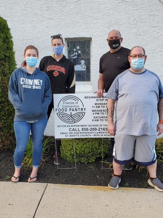 Volunteers from Friends of Clementon Food Pantry are shown in front of the pantry which is located at St. Mary's Episcopal Church in Clementon. Melynie Gordon Crow (left), Danielle Aubry, Dave Cornwell (rear right) and Christopher Hammond are pictured.