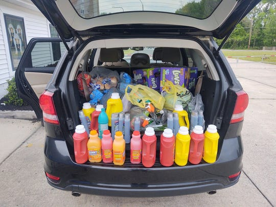 Donations for Friends of Clementon Food Pantry are shown in the vehicle owned by one of the volunteers, Melynie Gordon Crow, who assisted with starting the pantry.