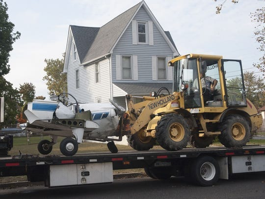 The wreckage of a two-seater aircraft is removed from a LIndenwold crash scene in October 2016.