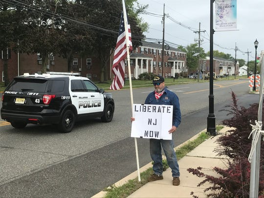 A demonstrator shows support for The Atilis Gym in Bellmawr.