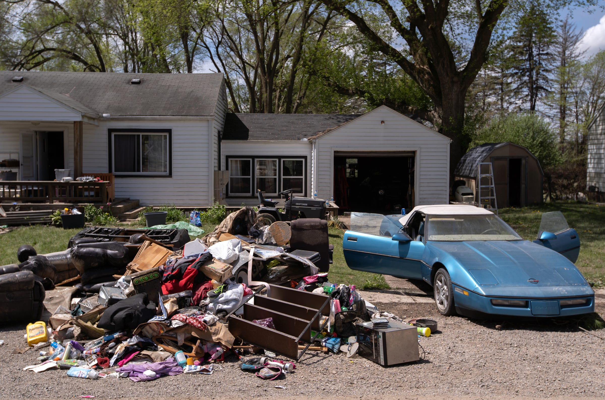 Randy Parsons' belongings are laid out at the curb of his home in Sanford on Friday, May 22, 2020.