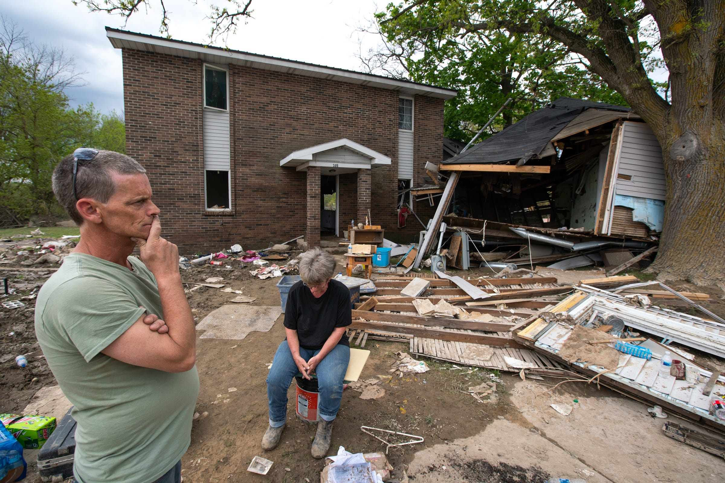 Clyde Hulett and his mother Sheryal Dice sit outside of their destroyed Sanford home on Friday, May 22, 2020.