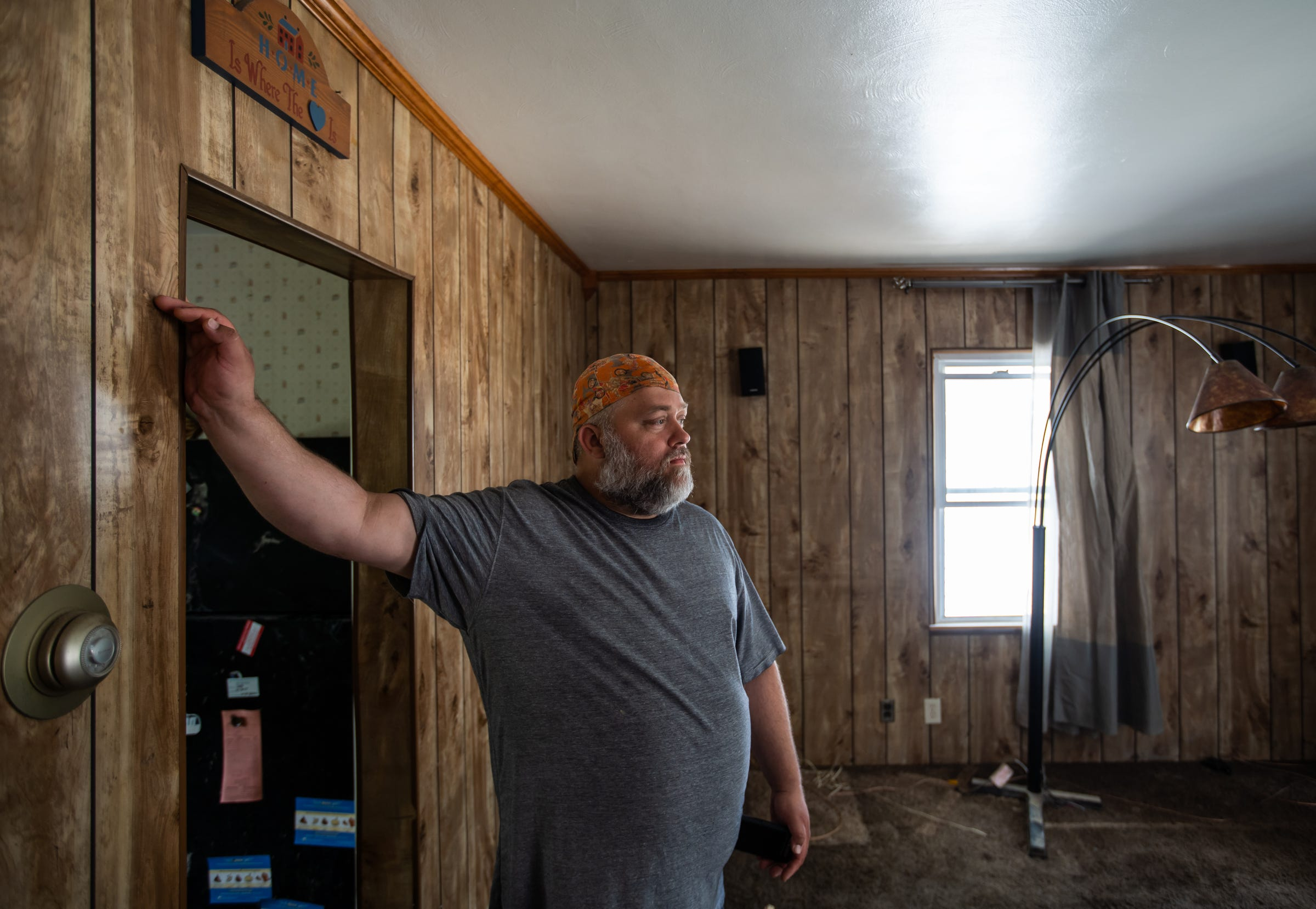 Randy Parsons of Sanford stands in his flood-damaged home on Friday, May 22, 2020.
