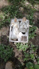 Mary and Joseph were found in the wreckage of the flood in Sanford. They were reunited with baby Jesus. Photo by: Dan Lippie