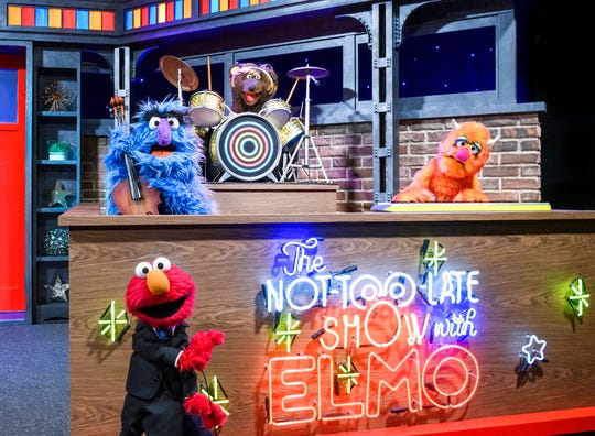 """This image released by Sesame Workshop shows muppet character Elmo, bottom left, who will host a family friendly show called """"The Not Too Late Show with Elmo."""" It begins streaming May 27 on HBO Max."""