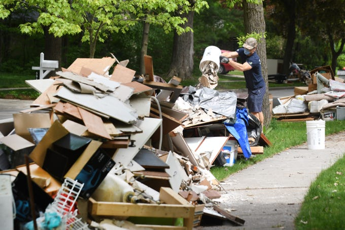 Work continues as the massive clean up due to flooding  last week in Midland along Woodbridge Lane on Wednesday, May 27, 2020