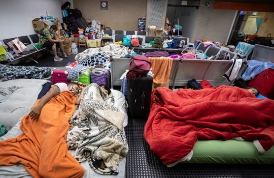Stranded Colombians sleep inside the Sao Paulo international airport while flights are severely limited during the COVID-19 pandemic in Guarulhos, Brazil, Wednesday, May 27, 2020.